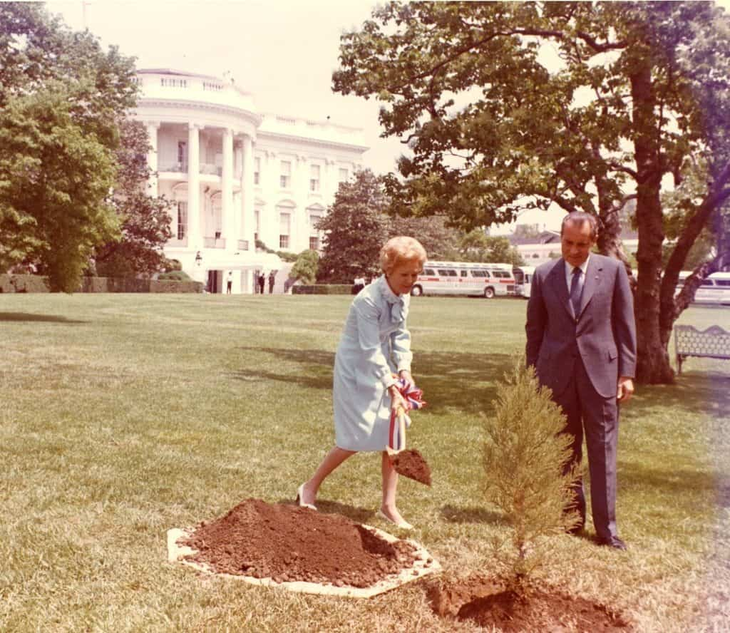 Nixon planted a tree at the White House for Earth Day.